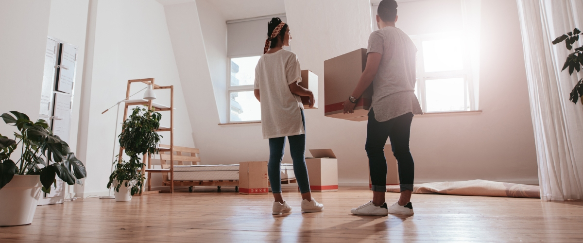 Couple holding boxes moving