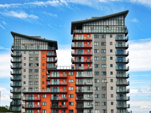 Grey and orange high rise condo