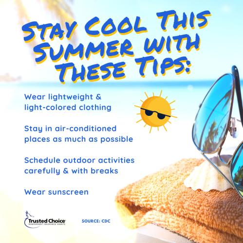 A towel and sunglasses near an ocean