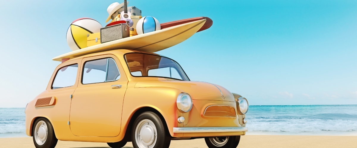 yellow car with surfboard